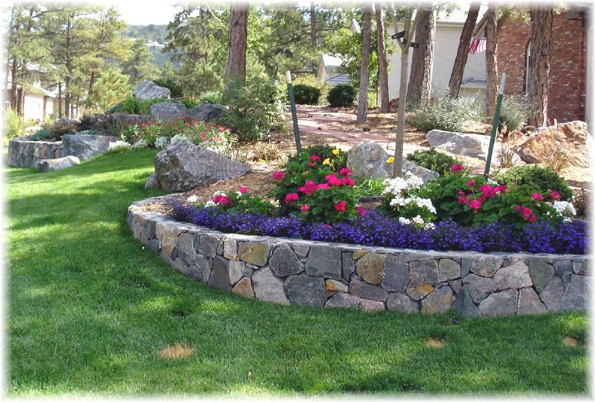 Unique landscapes and gardens inc for Retaining wall plants landscaping